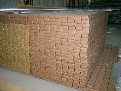There are so many water proof cartons orderly piled up, inside them are the expanded corner beads.